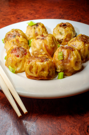Delicious Chinese Dim Sum dumplings topped with scallions