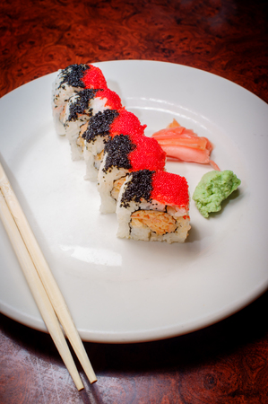 Beautiful spicy crab roll with black and red roe
