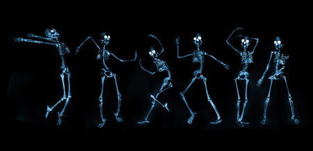 Silly dancing skeletons as seen through an xray machine Фото со стока