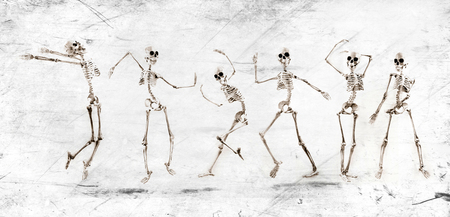 Silly dancing medical skeleton on grunge vintage background 版權商用圖片