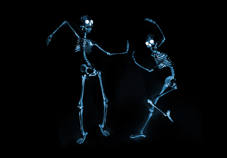 Silly dancing skeletons as seen through an xray machine 版權商用圖片