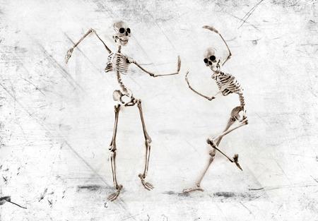 Silly dancing medical skeleton on grunge vintage background 版權商用圖片