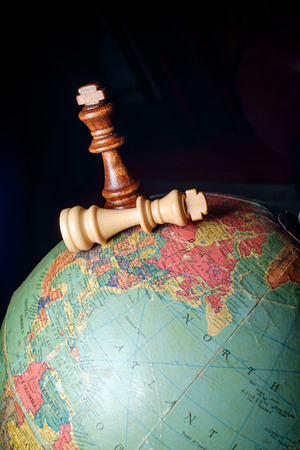 Chess kings winner and loser on globe map of the world Stock Photo