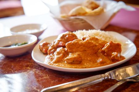 Authentic Indian cuisine Tikka Masala with momos mint and plum chutney with raita Stock Photo