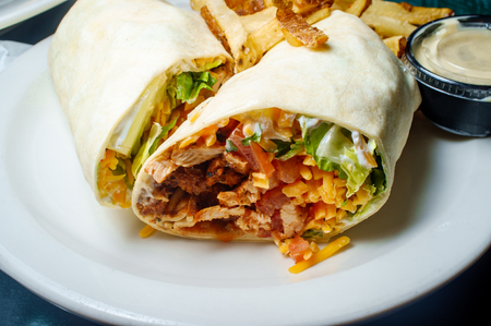 Spicy Mexican burrito wrap with french fries