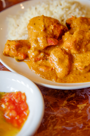 Authentic Indian cuisine Tikka Masala with momos mint and plum chutney with raita Stock Photo