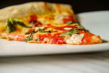 Large slice New York style Margherita pizza