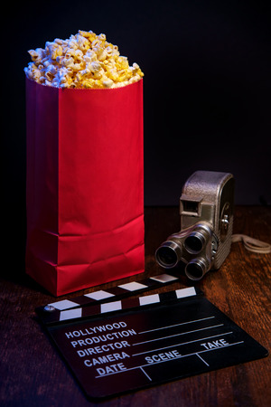 Movie theater popcorn with butter and blue backlighting Reklamní fotografie