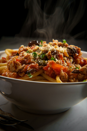Bucatini Italian ragu alla Bolognese sauce with sausage and toasted garlic bread crumbs