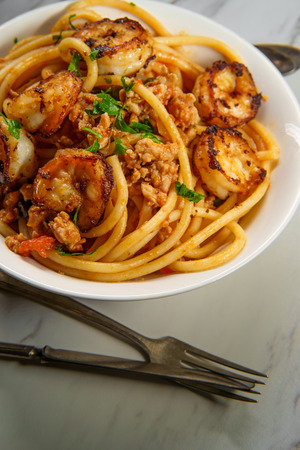 Bucatini Italian ragu alla Bolognese sauce with shrimp and sausage