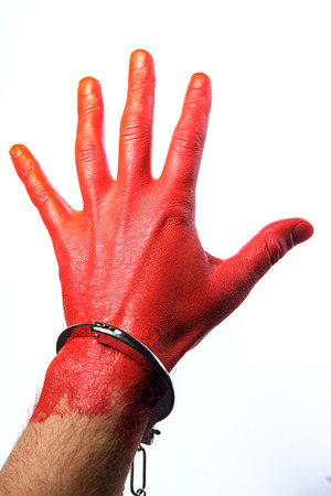 Caught red handed - hand painted red wearing handcuffs concept