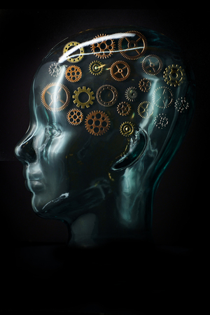 Gears inside glass head to symbolize brain activity for creativity and brainstorming Banco de Imagens