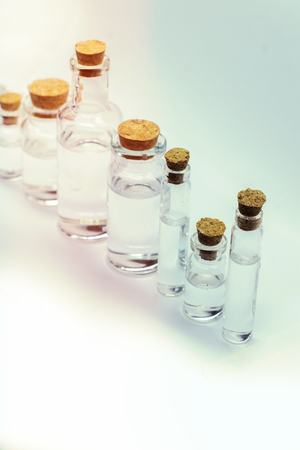 Close up glass measuring beakers for science experiment background