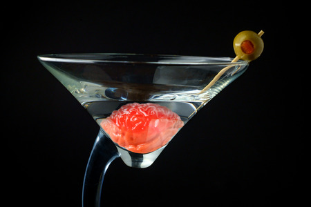 Human brain in martini glass soaking in liquor for alcoholism addiction concept