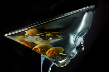 Martini glass has a face as though the liquor takes the place of the addicts brain