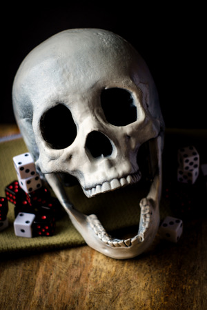 Grunge evil skull with gambling dice concept