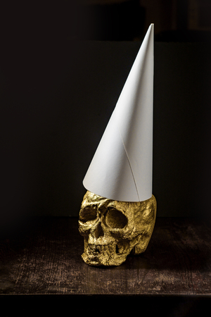 Gold skull fool made from fools gold wearing dunce cap