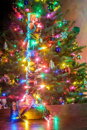 Heavy-hitter sledgehammer wrapped in Christmas tree string lights