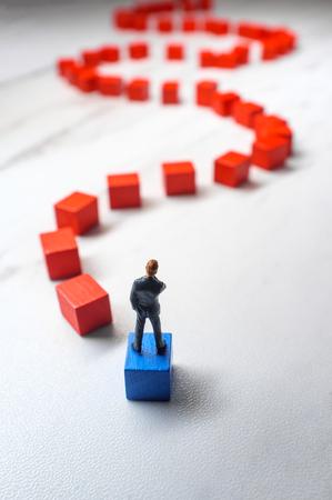 Miniature businessmen wooden blocks 写真素材