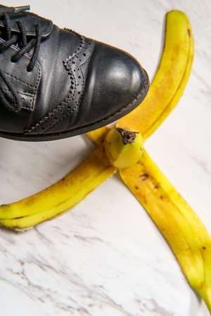 Comedy slippery banana peel with womens jazz shoe about to step on it