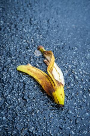 Slapstick slippery comedy banana peel laying on ground ready to make someone slip and fall