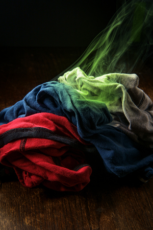Mens smelly underwear laundry with colorful visible odor vapor