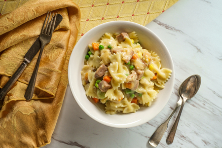 Chicken  pot pie pasta casserole with mixed vegetables and bowtie noodles