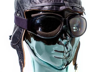 Robotic humanoid wears aviator hat as job automation or auto pilot metaphor concept