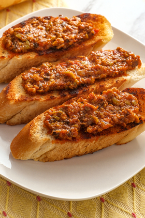 Traditional Portuguese olive bruschetta petiscos appetizer on crusty bread
