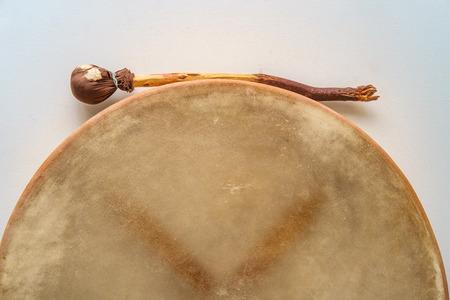 Traditional Irish bodhran drum hung on wall with tipper Banco de Imagens