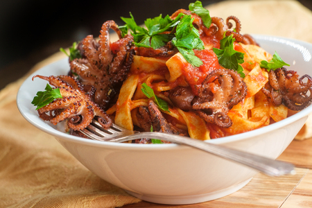 Italian tagliatelle con polpo grilled Octopus in tomato spaghetti sauce Stock Photo