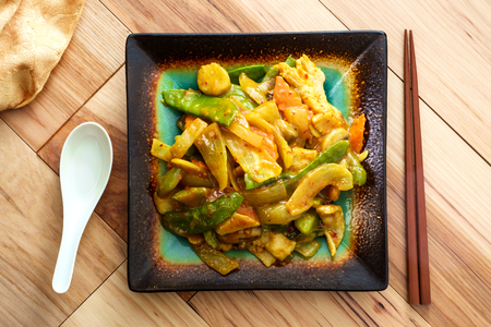 Chinese food chicken curry with sauteed vegetables