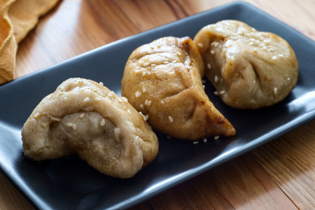 Delicious Chinese Dim Sum dumplings topped with sesame seeds Stock Photo