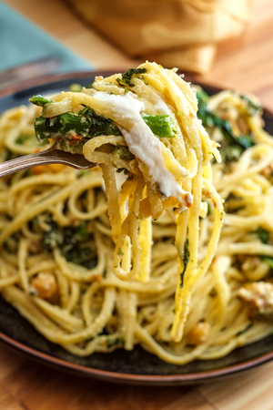 Linguine pasta with Italian sausage chickpeas and broccolini in a creamy ricotta cheese sauce