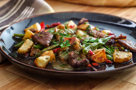 Chimichurri verde grilled steak and potatoes with red bell pepper and green beans