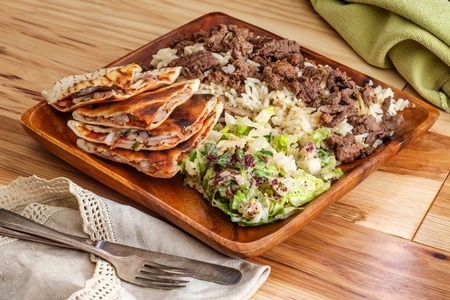 Authentic Middle Eastern veal Shawarma platter with vegetable ara'yes and side salad