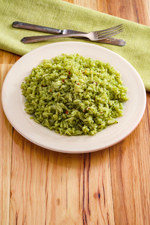 Simple yet flavorful Mexican green rice made with onions cilantro and spinach Stock Photo