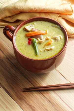 Spicy green thai curry with chicken and vegetables