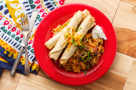 Mexican chicken and cheese taquitos with Santa Fe rice