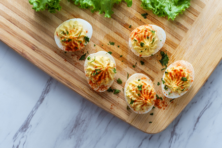 Stuffed Russian deviled eggs topped with parsley and paprika