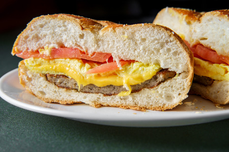 Sausage egg and cheese breakfast sandwich with tomato