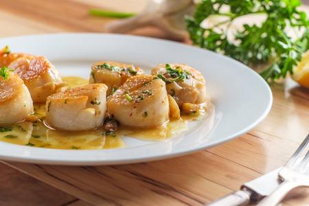 Seared Portuguese scallops in a white white wine lemon garlic sauce