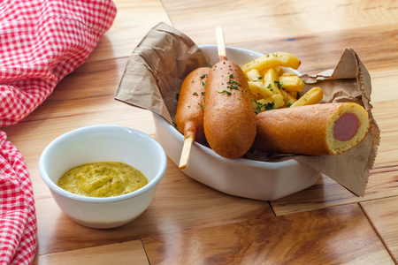 American fast-food cuisine corn dog served with steak fries