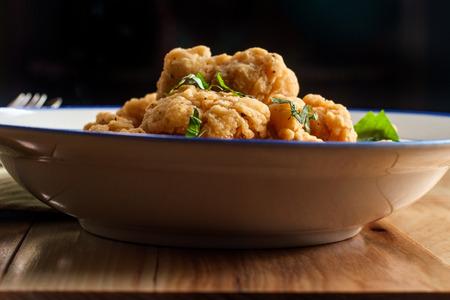 Homemade fast food crispy deep fried popcorn chicken bowl Stock Photo