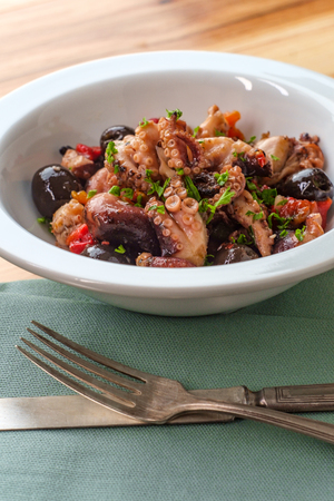 Spanish Octopus a La Vinagreta with oil and vinegar marinated kalamata olives and bell peppers Stock Photo