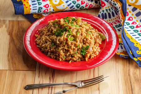 Mexican style Spanish rice with tomatoes onions and green bell peppers