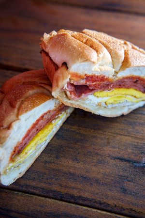 Taylor ham, pork roll, egg and cheese breakfast sandwich on a kaiser roll with salt pepper and ketchup from New Jersey