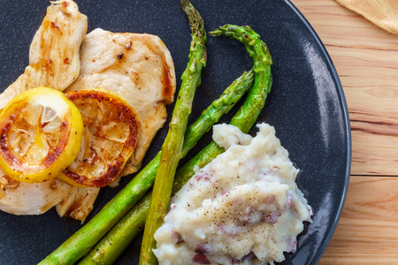 Italian chicken breast cutlets with honey lemon glaze and sides of skin-on mashed potatoes and steamed asparagus