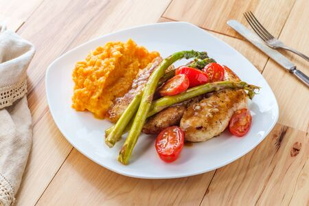 Balsamic glazed grilled chicken with grape tomatoes asparagus and mashed sweet potatoes