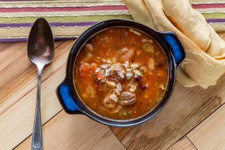 Slow cooker beef and vegetables soup with kidney beans and rice